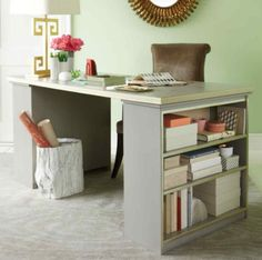 Use two small bookcases and a cheap door to build an inexpensive desk with lots of storage.