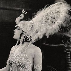 "Gloria Swanson in a white peacock head dress, in the 1919 Cecil B Demille classic ""Male and Female"""