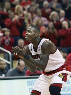 Louisville's Terry Rozier claps as he gets back on