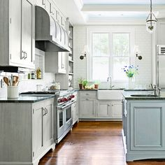 I am in love with this kitchen.  It's huge, open, and bright.  I also really like the distressed paint job on the cabinets.