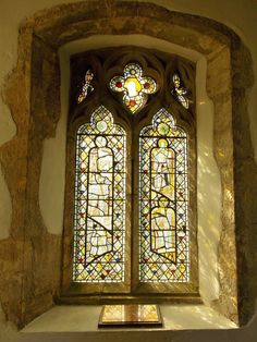 15th century stained glass in the 13/14th century St Nicholas Church in Sandhurst, Kent, England. By B Lowe
