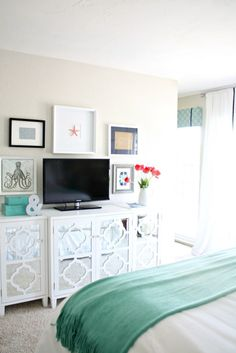 Grand Giveaway: Bedroom Makeover Reveal. A TV can look so much better when part of a gallery wall. Frames, artwork, and accessories all from HomeGoods. #sponsored #happybydesign #homegoodshappy