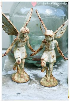 love these old rusty...chippy...white iron fairies