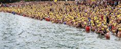thletes await the start of the swimming leg of the Ironman Zurich Switzerland Triathlon in the waters of Lake Zurich