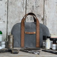 Apothecary Waxed Canvas Satchel | dotandbo.com  Hang on a fun hook for storage and display