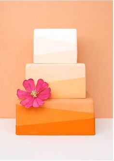 #Orange #ombre cake with pink flower accent by Eat Cake Be Merry #weddingcake