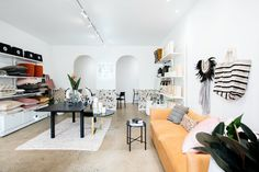 Alexa Nice has a new boutique showroom in James Street, New Farm. Retail Interior Design, Best Interior, Small Space Living, Living Spaces, Timber Table, Upholstered Ottoman, Hospitality Design, Occasional Chairs, Round Dining Table