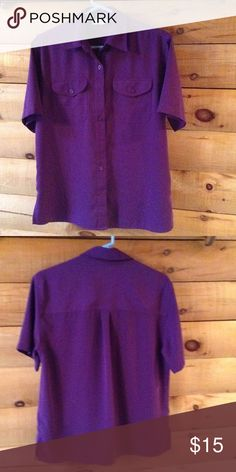 Purple Short Sleeve Shirt Silky Material. Purple Short Sleeve Silky Shirt with Full Front Button Down. Two Front Pockets with Button Down Flaps. One Pleat on the Back Yoke. Side slits. May be worn as a set with the listed purple floral blouse. PRICE IS FIRM!! Tops Button Down Shirts