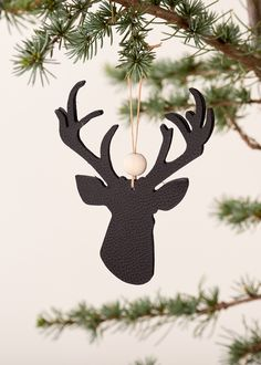 Handmade christmas ornament - leather reindeer black with wooden beads. Simple scandinavian christmas style and natural look... classic with a twist.