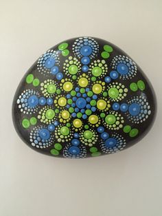 A personal favorite from my Etsy shop https://www.etsy.com/listing/279363552/mandala-stone-hand-painted-rock-dot