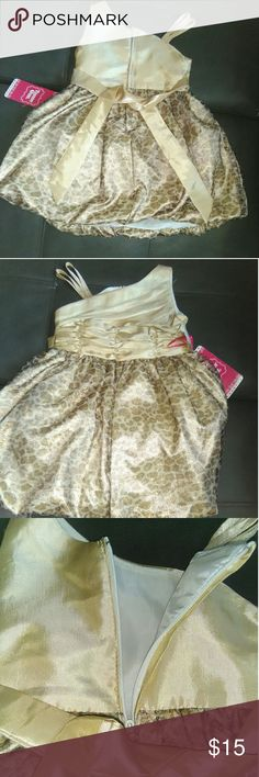 Girls Ruched 12 months Dress This new with tags 12 Months bubble bottomed dress is perfect for your lil lady. This mixture of beautiful hues of blush gold and brown hues a fancy appeal for the lil diva in your life. The ruched off the shoulder bodice of the dress and cheetah printed bottom adds a beautiful femininity to the dress. This Polyester dress by Trendy Girl is a great addition to your lil girls wardrobe. Snap this dress up before it's gone. This item has been cross posted…