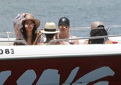 Pin for Later: The Kardashian-Jenner Sisters Just Offered Up Plenty of Last-Minute Swimspiration  Hats were a must have for the Kardashian-Jenner sisters as they boarded a boat to go parasailing.