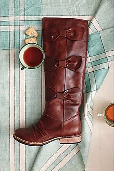 beautiful boots with bows by anthropologie, I love boots that don't have much of a heel!