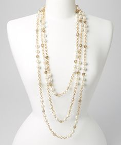 Look at this #zulilyfind! Gold & Cream Pearl Crystal Three-Strand Necklace by C.O. International #zulilyfinds