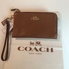 COACH Leather Double Zip Wristlet COACH Smith Leather Double Zip Wristlet Gold  double zipper. Wrist strap that detaches. 2 Interior pockets for credit cards or ID. Cloth lined. Perfect size to fit your cell phone & lip gloss, keys for a night out. Soft Leather NWT Sorry No Trades. Coach Bags Clutches & Wristlets