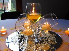 Elegance with wine glasses and candles. Perfect Vintage centerpiece.