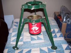 """Vintage Christmas Tree Stand ~ Red and Green Tin w/ Bells and """"Seasons Greetings""""."""
