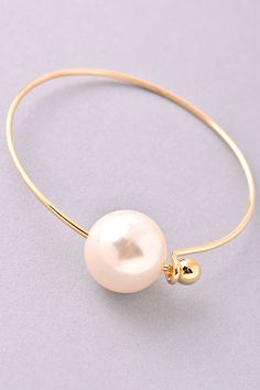 Gold Pearl Bangle Bracelet                                                                                                                                                      More