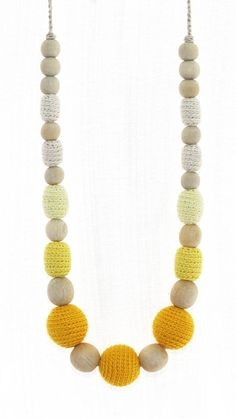 Nursing necklace is a kid-friendly jewelry piece for mom. My necklaces are made of natural materials only: wooden beads, cotton and linen yarns. This amazing necklace has 11 crochet covered beads in shades of white and yellow, and unfinished wooden beads. Finished with hand crocheted ties. This necklace makes lovely gift for new mom, expectant mother, baby shower gift for mom-to-be, birthday gift, Mothers Day gift. Nursing mothers could use this necklace while breastfeeding to catch babys…