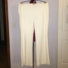 """Coldwater Creek White White Leg Dress Pants Up for grabs is this pair of dress pants from Coldwater Creek. They are a womens' size 18 with a 31.5"""" inseam, a 44.5"""" waist and 52"""" hips. These slacks have a flat panel front with a wide leg style. They are a white linen blend and are completely lined. These trousers have pockets on the hips and one on the rear. They have been gently worn and are in wonderful condition. Coldwater Creek Pants Wide Leg"""
