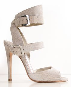 Camilla Skovgaard Beige suede pumps with subtle metallic circles in the leather. These heels are both sophisticated and sexy perfect for both day and night outings. The neutral color is extremely versatile for any outfit and the buckle straps add a timeless edgy look. The heels are slightly worn on the bottom of the soles, with only minor signs of wear above the sole. Heel height (5 inches).