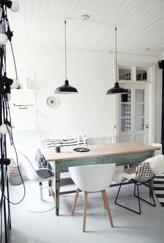 mismatched dining chairs in a modern farmhouse