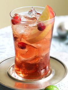 Red Apple Crisp:   2 tablespoons spiced rum, 1-2 tablespoons cranberry juice, 1 tablespoon red apple liqueur, 2 tablespoons club soda, red apple slices, fresh cranberries. cover and shake well