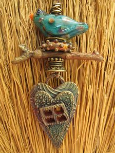 Wayne Robbins glass bird bead and Judie Mountain bronze window heart, branch, nest. www.judiemountain.etsy.com