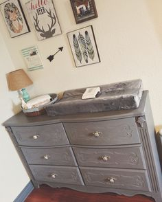 Check out this adorable woodland themed nursery and this vintage gray dresser! We offer a variety of changing pad covers to match any nursery and our straps will keep your little one from wiggling around during changes! #Poopoose #woodland #Nursery  Poopoose.com