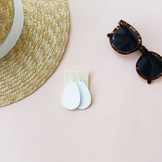 Leather Earrings. Crisp, clean, statement making. This leather comes in all of our styles and sizes AND it has the new clear backing on the leather for easy cleaning. Have you snagged a pair of Select White earrings yet? #summerwhites #nickelandsuede #leatherearrings