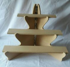 Corner craft glasses cups frames sweets display stand craft Mdf corner display stand ready to be painted goods in half for easy storage Height 51 cm Top shelf 38 cm by 6 cm Middle shelf 51 cm by 10 cm Bottom shelf 64 cm by 10 cm Market Stall Display, Vendor Displays, Craft Booth Displays, Market Displays, Doll Display, Craft Booths, Wood Display Stand, Craft Stalls, Craft Markets