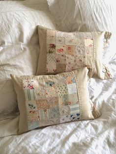 She has combined linen with beautiful faded vintage fabrics. via The Hen House -- This looks like a quilt piecing project I could actually do.vintage/pastel blocks sewn into pillows. HenHouse: Spring has SprungFarm House Blessings~Old Fashion Vintage