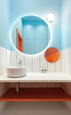 Turquoise and orange bathroom