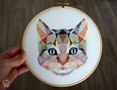 Geometric Cat Counted Modern Cross Stitch PDF Pattern. This pattern is an instant download PDF.  Size: 94w x 110h stitches 18 Count Aida: approx. 5.2w x 6.1h inches or 13.3w x 15.5h cm 16 Count Aida: approx. 5.9w x 6.9h inches or 14.9w x 17.5h cm 14 Count Aida: approx. 6.7w x 7.8h inches or 17.0w x 20.0h cm Stitches Required: Full cross stitches Colors Required: 28 DMC floss colors  The sample was made on 18 count aida and framed in a 8 hoop.  PDF Included: - Pattern in color symbols with…