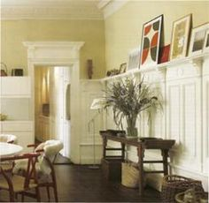 I love the wainscoting... and then with the frames on the ledge going around.