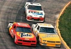 Geoff Bodine and Darrell Waltrip's Hendrick Monte Carlos battle, while Alan Kulwicki's Thunderbird lays in wait.