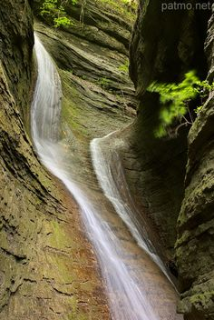Double waterfall in a sandstone canyon.