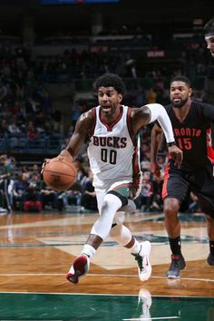 O.J. Mayo #00 of the Milwaukee Bucks drives to the basket against the Toronto Raptors during the game on January 19, 2015 at BMO Harris Bradley Center in Milwaukee, Wisconsin.