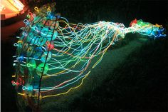 To create this sculpture, artist Nancy Cohen collaborated with Jim Sturm, professor of electrical engineering, and Shirley M. Tilghman, president of Princeton University and professor of molecular biology. The piece, seen here illuminated at night, is an abstract representation of the how mammals sense smell and remember scents.
