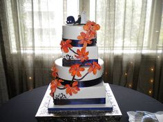 Orange & Navy Wedding Cake.. Change the blue to purple and it would be AMAZING for a fall wedding :)