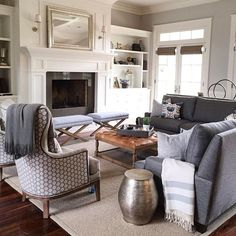 I get emails about this room all the time! Sofa and ottoman are custom and those darling chairs are from @gatehouseno1  In my opinion that ottoman is the perfect shade of leather.