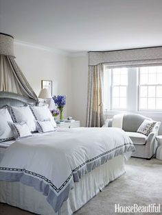The soft tones of the master bedroom start with the Elizabeth Dow wallpaper and continue in the Muriel Brandolini print on the bed canopy and valance.