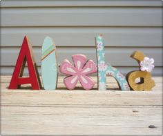 Aloha letter set with Pink Hibiscus flower and surfboard. $27.99, via Etsy.