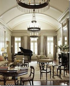 This whole blog post is about living rooms designed around grand pianos.  Lots of great ideas.