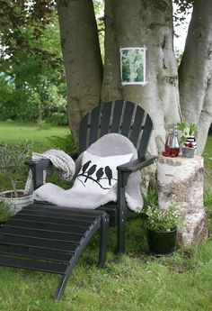 If you're looking for outdoor decor inspiration, check out these gorgeous outdoor reading nooks. Including this simple adirondack chair complete with a tree stump side table. Outdoor Rooms, Outdoor Chairs, Outdoor Living, Outdoor Decor, Adirondack Chairs, Outdoor Photos, Outdoor Seating, Luxury Garden Furniture, Outdoor Furniture