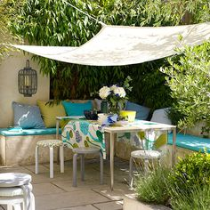 Garden shelter from the sun with table and chairs