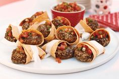 Beef patties in tortilla pockets with tomato salsa main image