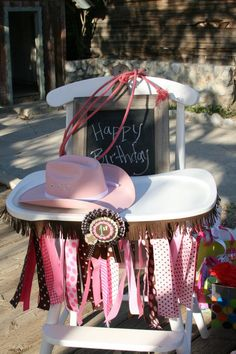 Real lariat and cowgirl hat.... 1st Place ribbon and added fringe Joanne Fabric. High chair ribbons from http://www.polka-dot-market.com/