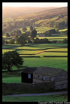 Stone barns in Yorkshire Dales, England @Thomasina Metts - I know you took this same exact picture!!!! - minus the dead cow.