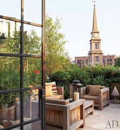 This small terrace proves you don't need acres of space to create a really chic outdoor room - we love it!